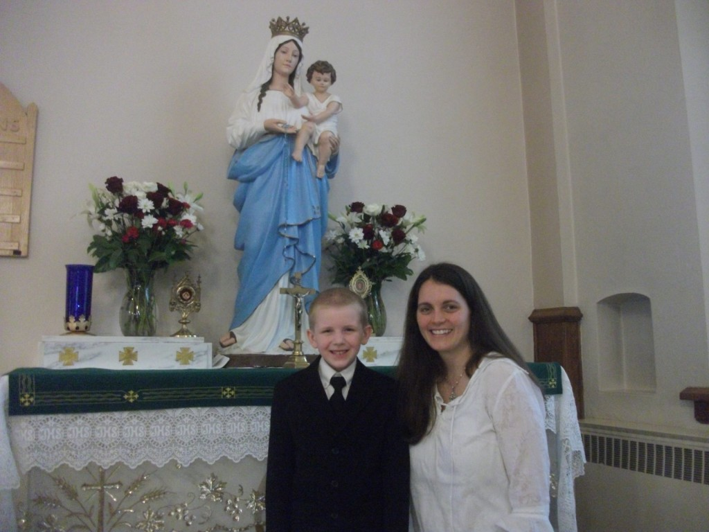 With Our Lady and his Godmother Laura