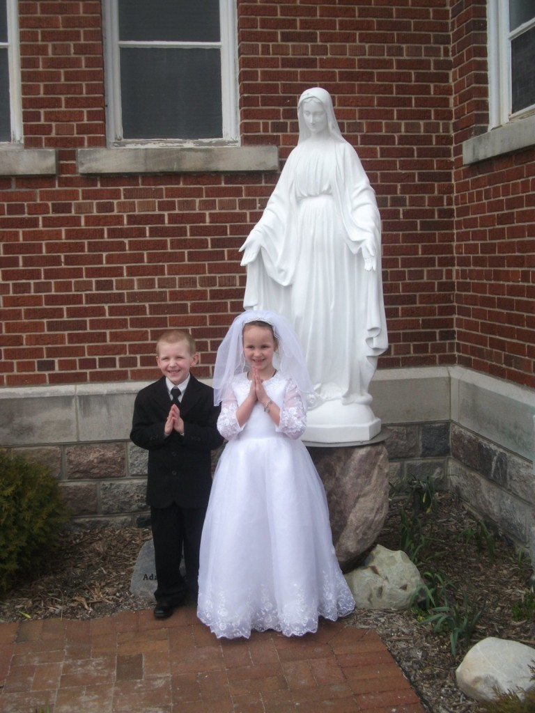 With Our Lady and his cousin Gianna